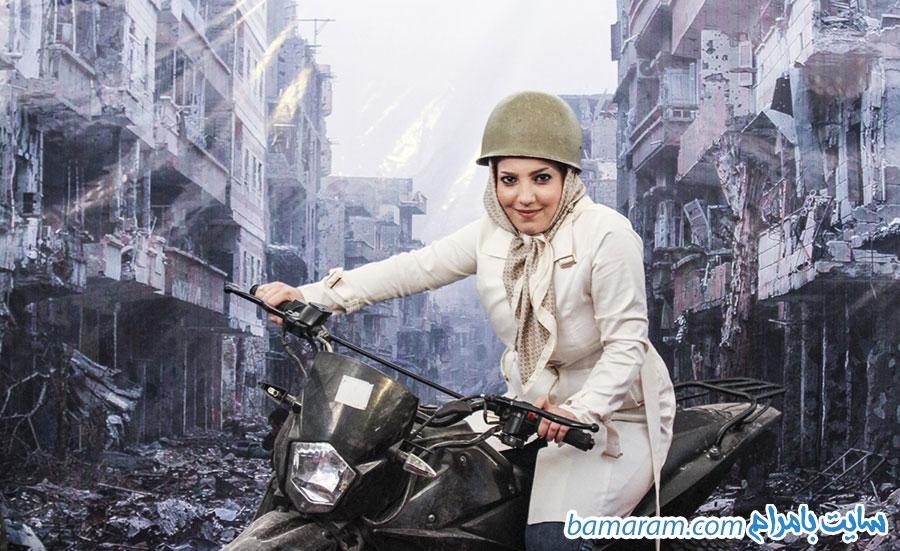 خرابه های سوریه نمایشگاه کتاب مدافعان حرم دختر موتورسوار